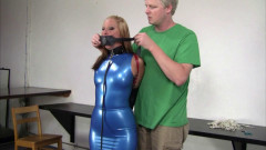 Secretary in a blue latex dress, collared, leashed & trained