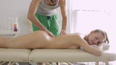 Julie lifts one leg to let masseuse get a better view of her pussy